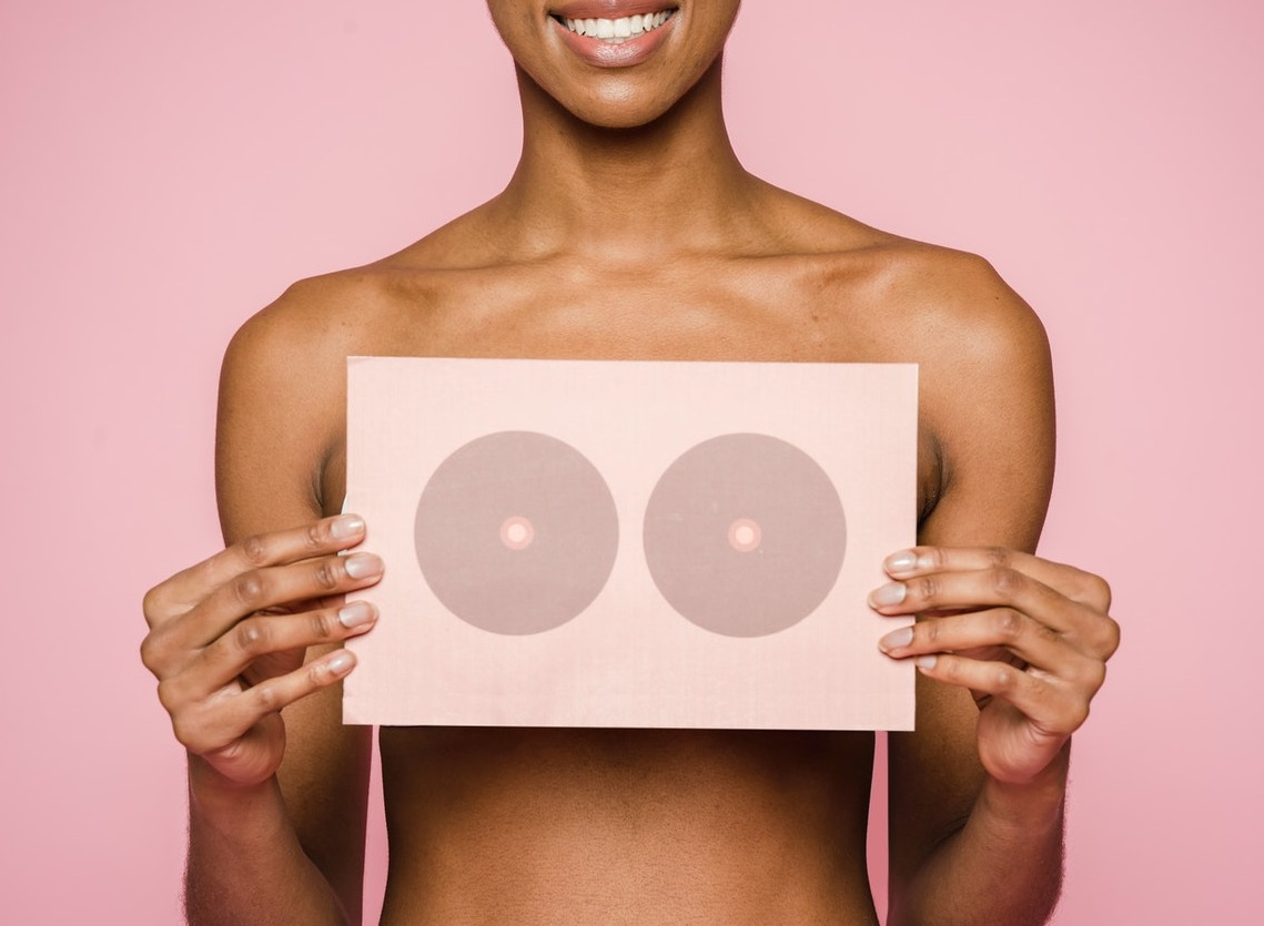 What are the first signs of breast cancer?